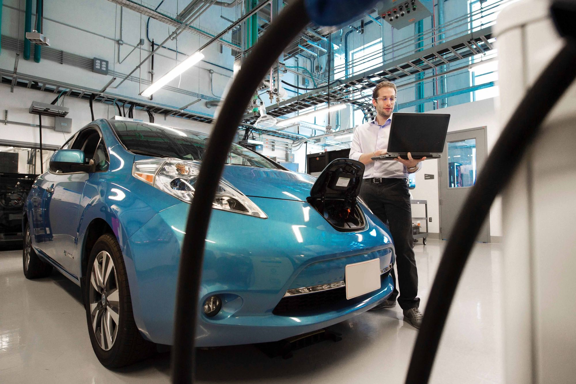 Blue electric car vehicle in a body repair shop